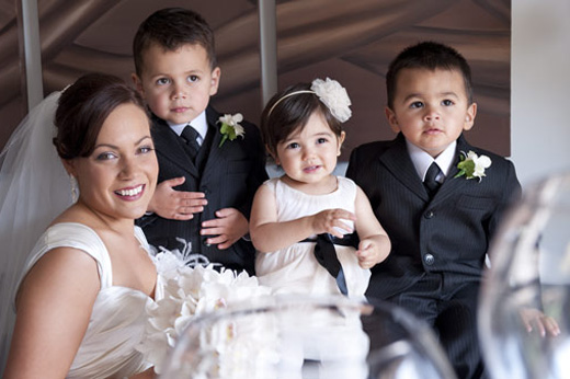 bride with flowergirl and page boys