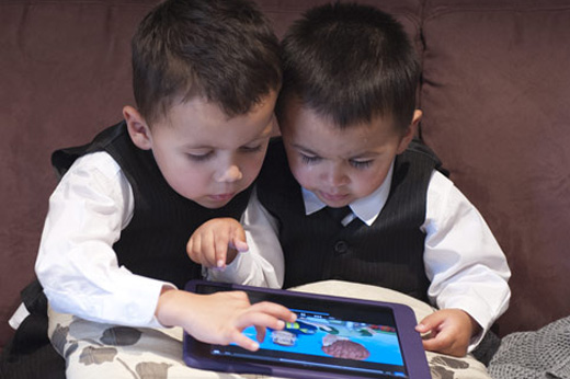 junior wedding page boys play with iPad