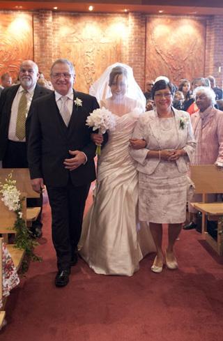 both parents walk bride down aisle