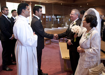 father of bride shakes hands with groom