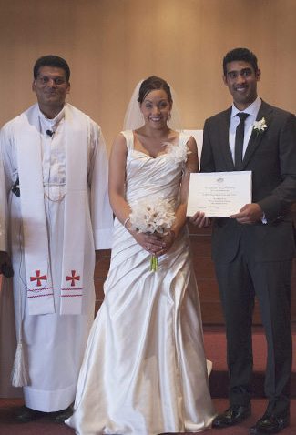bridal couple receive marriage certificate
