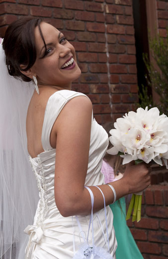 bride looks back and laughs to camera
