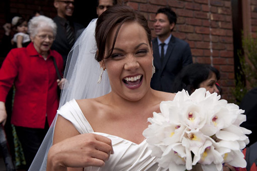 wedding photo shows bride laughing