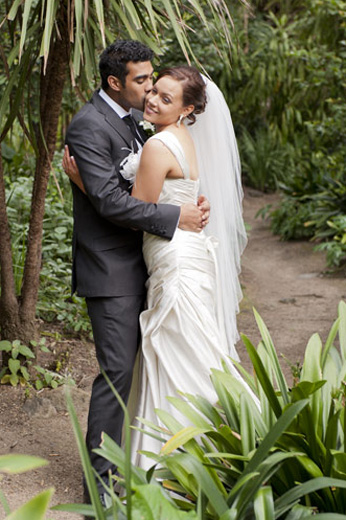 wedding couple in tropical setting within Fitzroy Garden