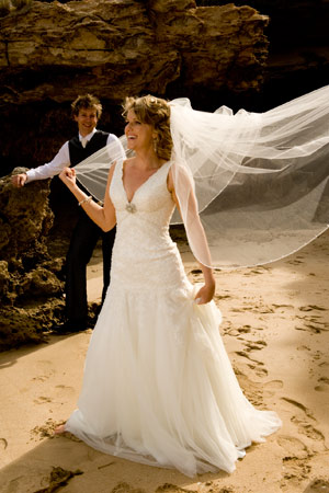 natural laughter in beach side wedding photo