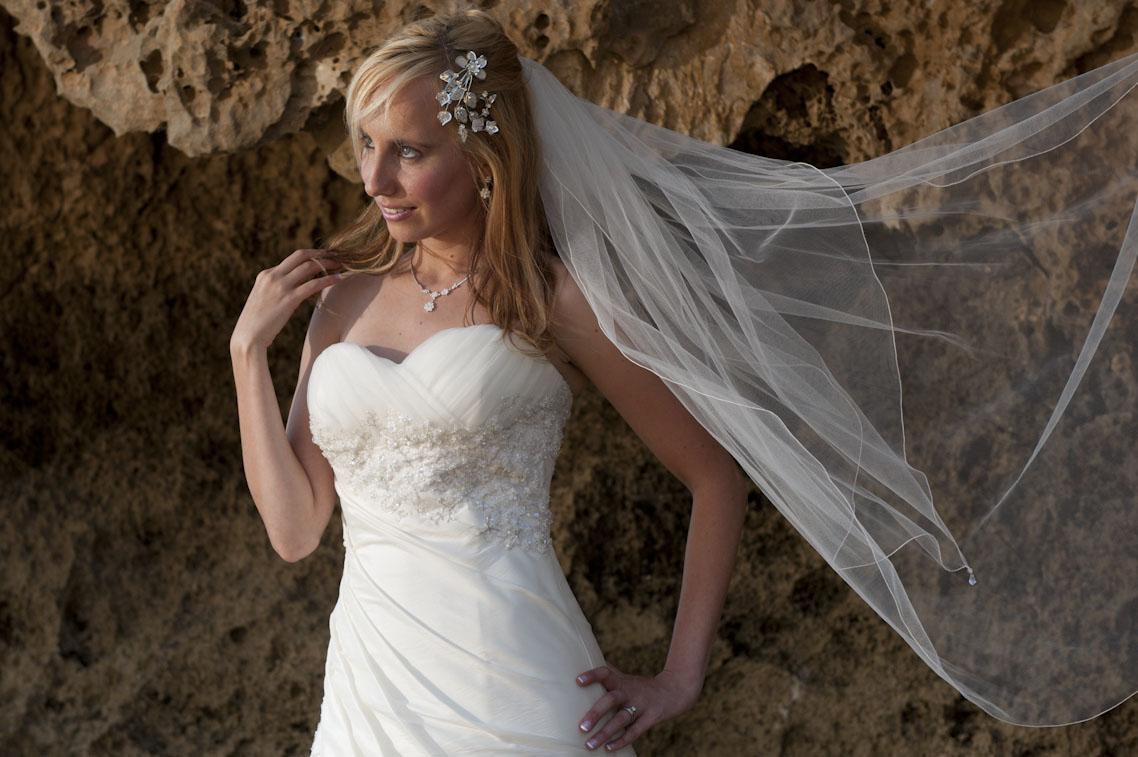 beach wind lifts bridal veil in the air