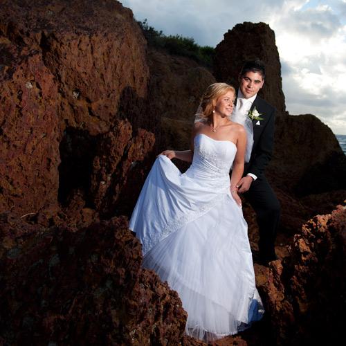 beach side rocks frame wedding couple