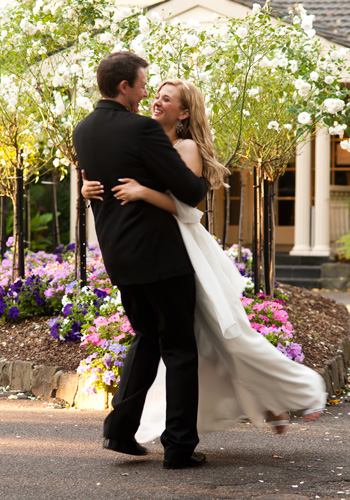 wbridal couple dance in the garden at bram leigh