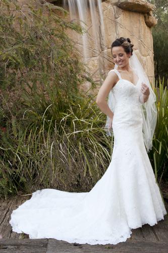 bride next to waterfall in potters garden warrandyte