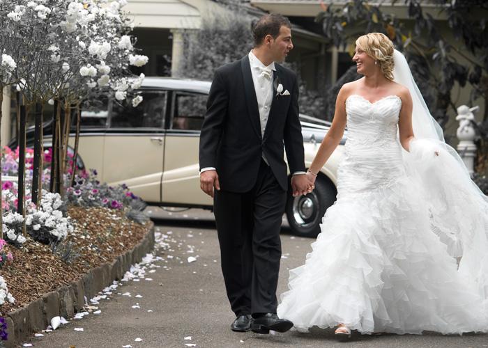 newlyweds walk along the garden path at bram leigh garden, Croydon