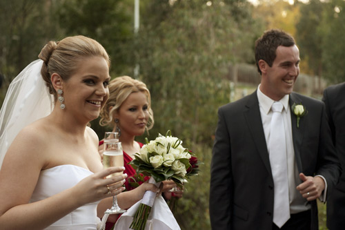 bride and groom share fun with bridal party