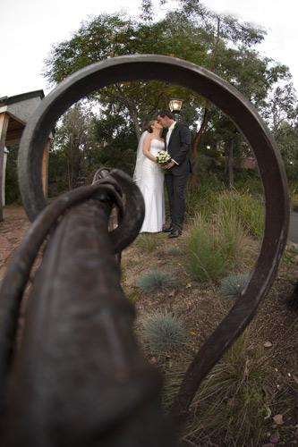wedding photo using creative compositon within garden setting