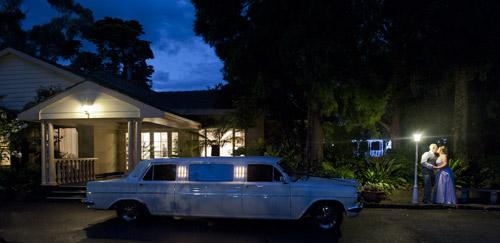 night wedding photo with EH limousine in garden