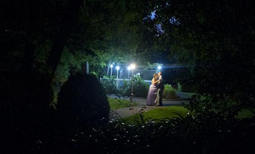 night photo of garden wedding couple at bram leigh