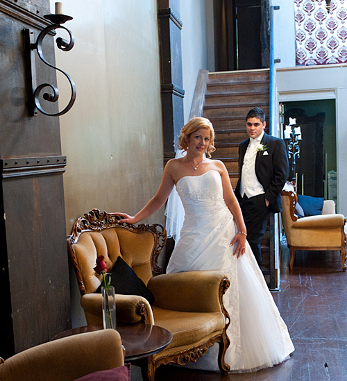A bride and groom by the Melbourne bar staircase