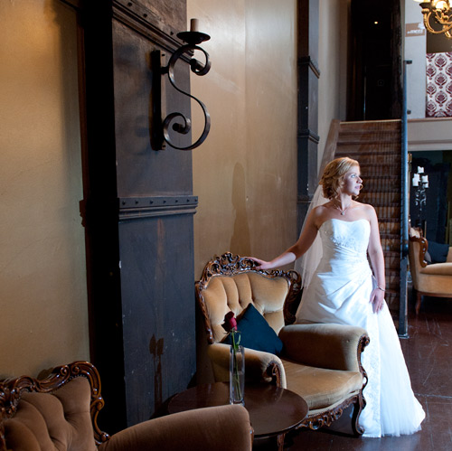 Photography of Wedding a bride on her wedding day, with an old staircase as a backdrop