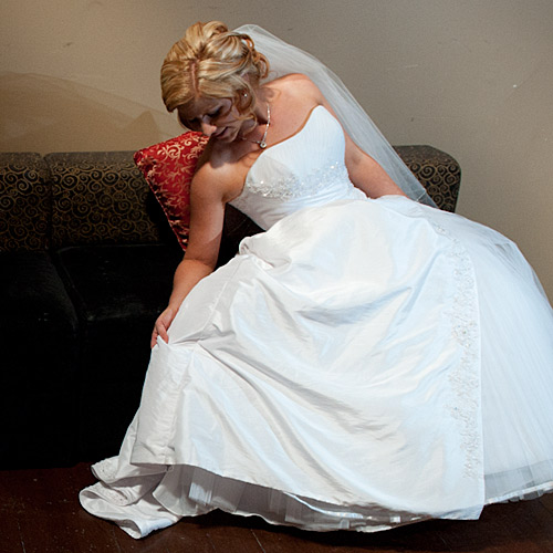 An olde worlde setting a bride looking at her gown