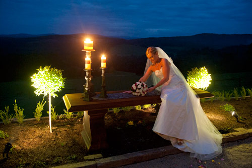 wedding photography melbourne- night shot a bride is photographed with candle light illumination