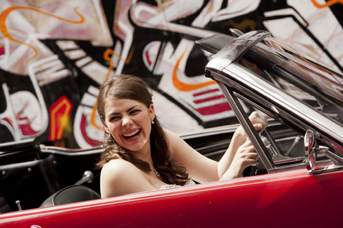 Photography of Wedding in Hosier lane Melbourne, with a bride behind the wheel of a mustang convertible.