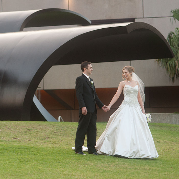a bride and groom on the lawn outside the Arts Centre Wedding Photography Melbourne