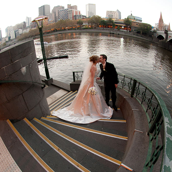 on the stairway leading to  Southbank nd the Yarra River Wedding Photography Melbourne.