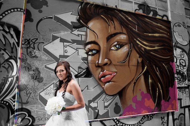 Wedding Photographers captures this beautiful bridal portrait with a backdrop of graffiti art Melbourne.