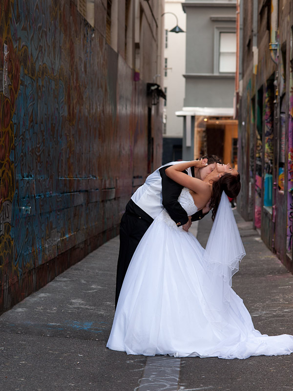 A wedding photo, by the Wedding Photographers team, showing a bridal portrait in a city lane way Melbourne.